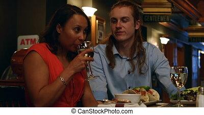 Couple talking in night club 4k - Romantic couple talking in...