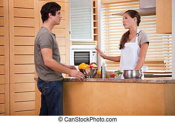 Couple talking in the kitchen