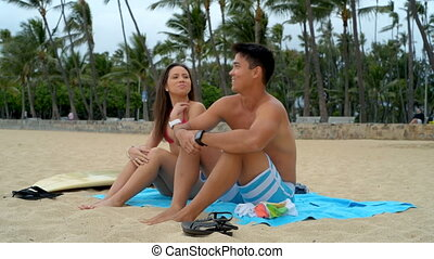 Couple talking on the beach 4k - Young couple talking on the...