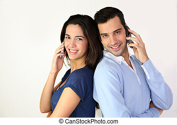 Couple talking on the mobilephone