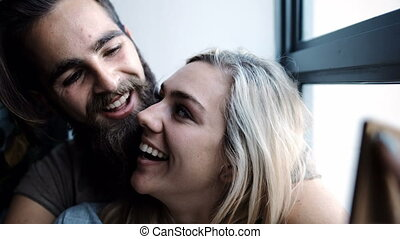 Couple talking selfie with mobile phone in living room 4k -...