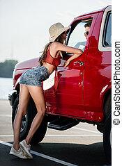 couple talking through car window