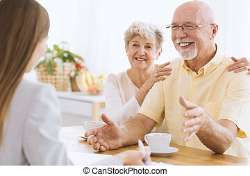 Couple talking to insurance agent