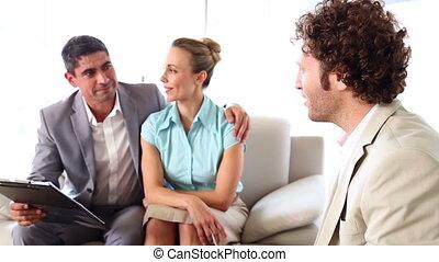 Couple talking to their financial adviser