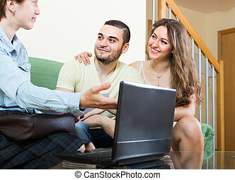 Couple talking with social worker at home