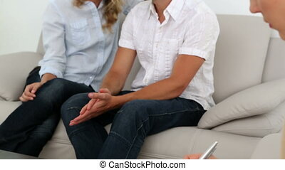 Couple talking with their therapist