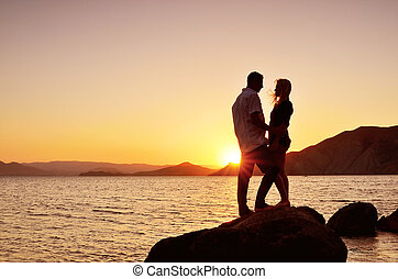 Couple talks at the sea - Young couple talking to the sea at...