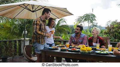 Couple Telling Toast Standing Up People Eating On Terrace...