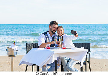 Couple they make a selfie on the beach