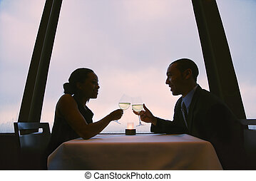 Couple toasting glasses.