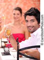 Couple toasting in restaurant
