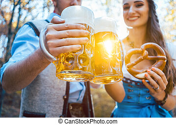 Couple toasting with beer in Bavaria