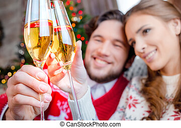 Couple toasting with champagne glasses