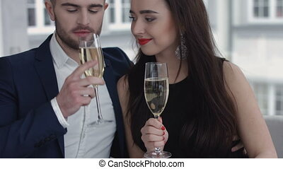 Couple toasting with champagne in the restaurant