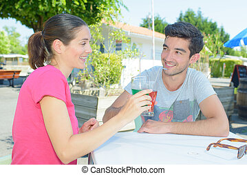 Couple toasting with their drinks