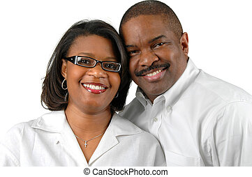 Couple Together Smiling - Portrait of a couple over a white...