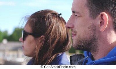Couple tourists floating on a boat tour on the canals of St....