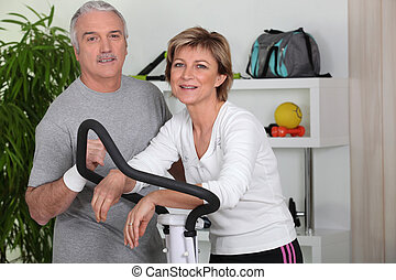 Couple training in home gym