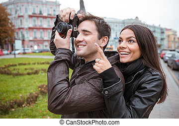 Couple traveling and making photo on camera