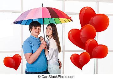 Couple under a umbrella