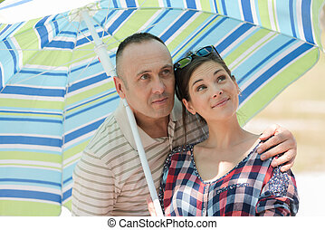 couple under parasol