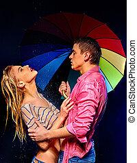Couple under rain with umbrella
