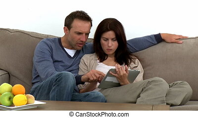 Couple using a computer tablet