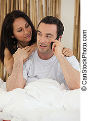 Couple using a telephone
