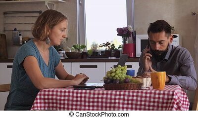 couple using device in house