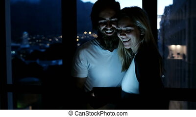 Couple using digital tablet at home 4k - Happy couple using...