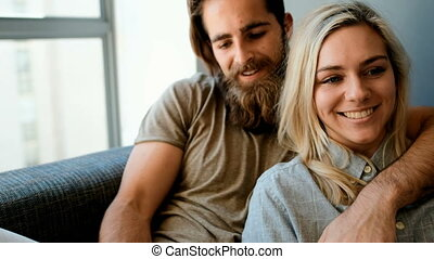 Couple using digital tablet in living room 4k - Couple using...