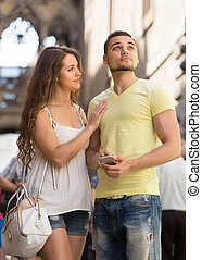 Couple using the map at smartphone