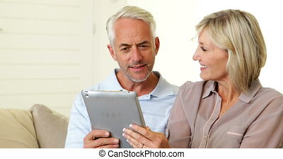 Couple using their tablet together
