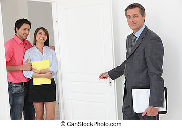 Couple viewing a property with an estate agent