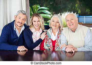 Couple Visiting Grandparents At Nursing Home