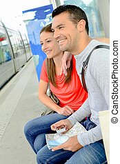 Couple waiting at train station
