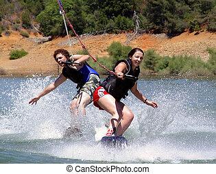 Couple wakeboarders