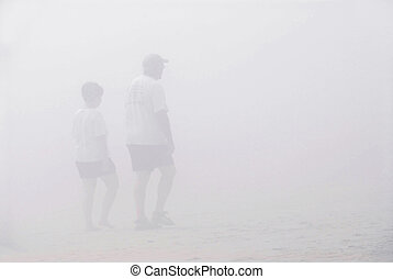 Couple walk fog