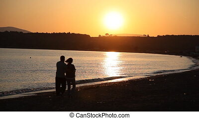 couple walking at sunset HD 1080p
