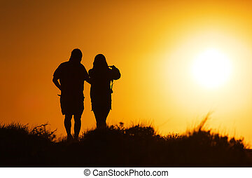 Couple walking at sunset