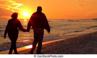 Couple Walking Away At Sunset