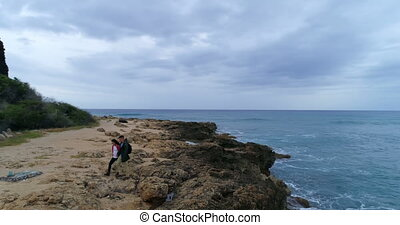 Couple walking away from the sea coast 4k - Carefree couple...