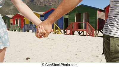 Couple walking hand in hand at beach 4k
