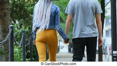 Couple walking hand in hand in the city 4k