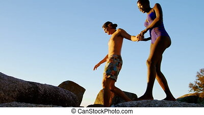 Couple walking hand in hand on the rock 4k