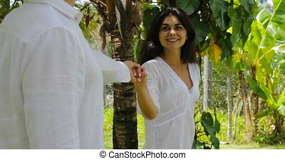 Couple Walking Holding Hands In Tropical Garden, Happy Man...