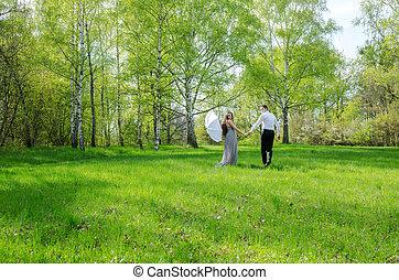 Couple walking in a meadow