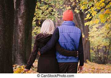 Couple walking in autumn park