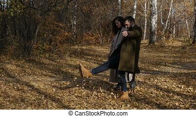 Couple walking in autumn park