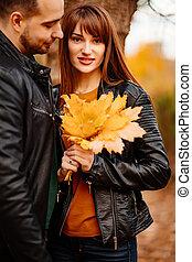 couple walking in autumn Park. romantic walk.